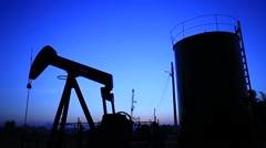 Stock Video Footage of Silhouette Moving Oil Pumpjack (Sucker Rod Beam) at Sunset Time