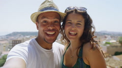 Happy attractive young couple on vacation engaged in a video call Stock Footage