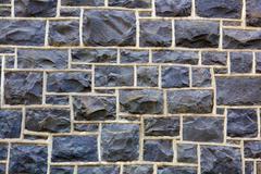 rectangular stone wall further away - stock photo