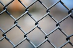 chain link fence up close - stock photo