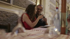 Attractive mixed race couple drinking wine in an Italian restaurant - stock footage