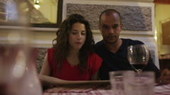 Attractive mixed race couple drinking wine in an Italian restaurant Stock Footage