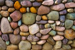Multi-colored stone wall background Stock Photos