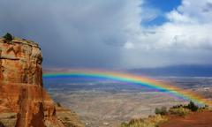 rainbow over grand junction - stock photo