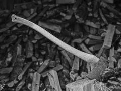 Axe and woodpile Stock Photos
