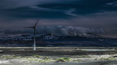 Electricity generating wind turbine in front of Hekla Volcano, surreal lighting Stock Footage