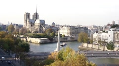 Notre Dame Cathedral with Boat on the River Seine Stock Footage