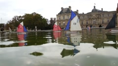 Small Sailboats Floating on a Lake (Close Up) - Paris, France Stock Footage