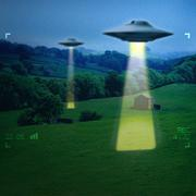 UFO in a meadow - stock photo