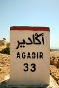 Sign road on the way to Agadir - stock photo