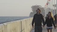 Man and Woman Couple Walk Down Pier Boardwalk 4K Stock Video Footage Stock Footage