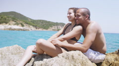 Happy attractive couple in love, relaxing together on mediterranean beach Stock Footage