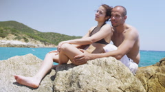 Happy attractive couple in love, relaxing together on mediterranean beach - stock footage