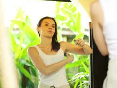 Woman applying antiperspirant on her armpit in the bathroom NTSC Stock Footage