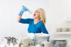 Modern kitchen - woman pretend to sing song Stock Photos