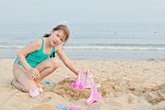 Happy little girl on the beach Stock Photos