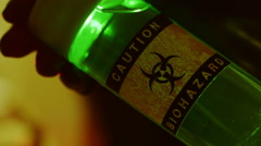 Tech holding a biohazard sample Stock Footage