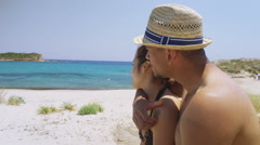 Portrait of happy attractive couple in love on beautiful mediterranean beach - stock footage