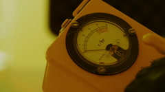 Taking a Geiger counter reading Stock Footage
