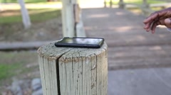 Hand Taking Cellphone Stock Footage