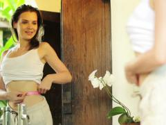 Stock Video Footage of Happy woman measuring her waist with tape in bathroom NTSC