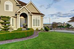 Luxury house exterior. entrance porch view Stock Photos