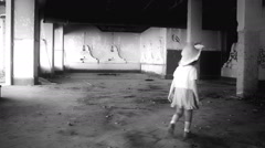 Abandoned little girl in ruined house,black & white Stock Footage