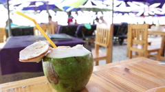 Fresh coconut on table at Hua Hin beach restaurant , Thailand Stock Footage