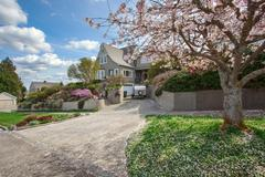 House exterior with blooming cherry tree Stock Photos