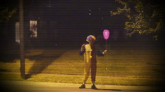 Creepy clown in the street 2 Stock Footage
