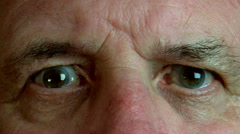 Senior male eyes stare at camera Stock Footage
