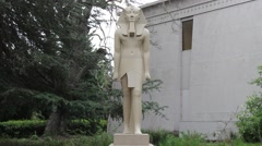 Egyptian Museum Artistic Statue with Trees Background - stock footage