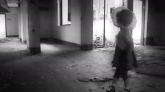 Horror Scene abandoned little girl in ruined house,black & white Stock Footage