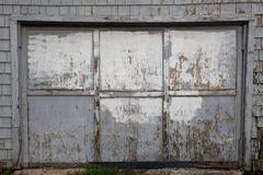 Old worn out gray garage door Stock Photos