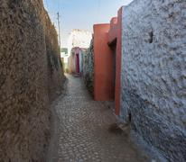 narrow alleyway of ancient city of jugol in the morning. harar. ethiopia. - stock photo