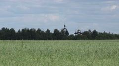 Cupola of Russian Orthodox Church on the field - stock footage