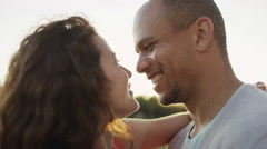 Portrait of happy couple in love, outdoors in the sunshine Stock Footage