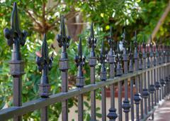 black spike fence deeper dof - stock photo
