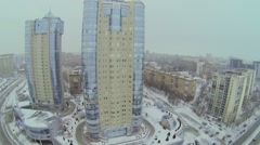 City traffic near dwelling complex Rook at winter. Aerial view Stock Footage