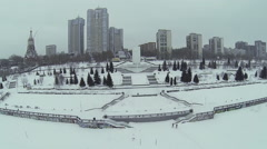 Snowbound city quay with monument and dwelling houses Stock Footage