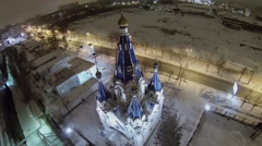 Traffic on road near edifice of church at winter evening Stock Footage