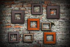 Grungy old wall full of wooden frames for your message or design, artistic ba Stock Photos