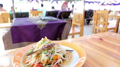 Serve papaya salad Som Tam at the restaurant beach Stock Footage