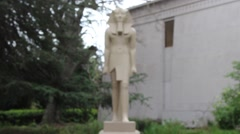 Egyptian Museum Artistic Statue with Trees Blurry Background - stock footage