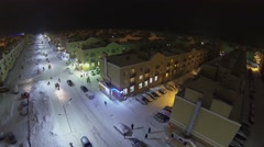 People walk by street with identical houses of Koshelev project Stock Footage