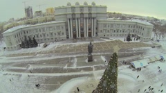 Christmas tree near monument and edifice of Academic Theater - stock footage