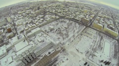 Cityscape with skating rinks near edifice of theater Stock Footage