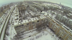 Cityscape with street traffic and residential houses at winter Stock Footage
