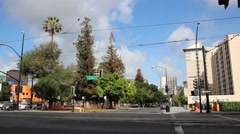 Stock Video Footage of Downtown Building and Street View with Trees
