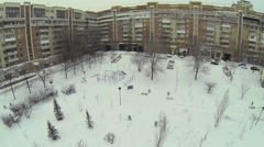 Snowbound yard with playground and plants near residential house Stock Footage
